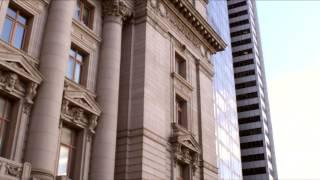 Tracking Shot Of Intricate Building With Columns