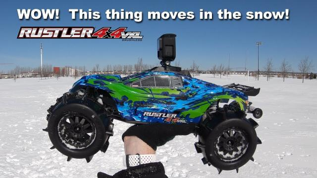 Driving Crazy Fast in SNOW with Sand Paw Paddle Tires - Traxxas Rustler VXL 4X4